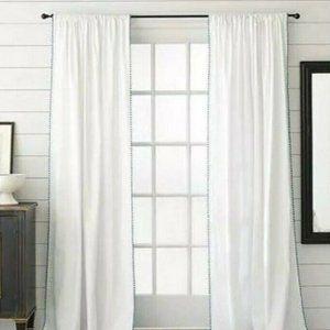 nate berkus. grey fringe, white curtain panel.